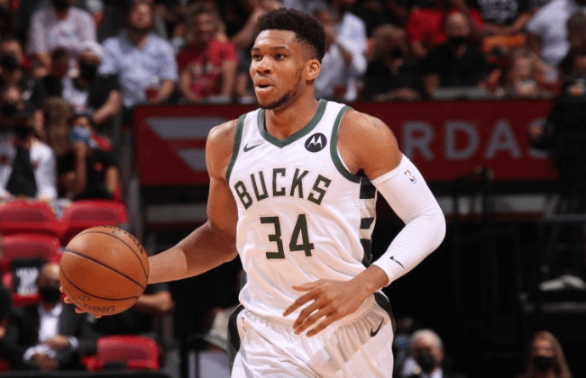 MIAMI, FL - MAY 29: Giannis Antetokounmpo #34 of the Milwaukee Bucks dribbles the ball during Round 1, Game 4 of the 2021 NBA Playoffs on May 29, 2021 at American Airlines Arena in Miami, Florida. NOTE TO USER: User expressly acknowledges and agrees that, by downloading and or using this Photograph, user is consenting to the terms and conditions of the Getty Images License Agreement. Mandatory Copyright Notice: Copyright 2021 NBAE (Photo by Issac Baldizon/NBAE via Getty Images)