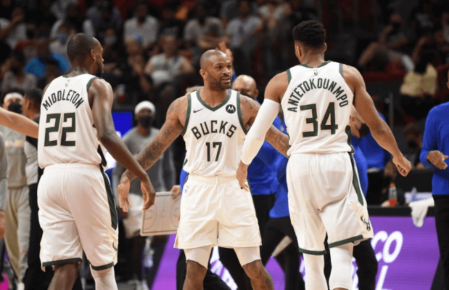 MIAMI, FL - MAY 29: Khris Middleton #22 of the Milwaukee Bucks, P.J. Tucker #17 of the Milwaukee Bucks, and Giannis Antetokounmpo #34 of the Milwaukee Bucks high-five during Round One Game Four of the Eastern Conference Playoffs on May 29, 2021 at AmericanAirlines Arena in Miami, Florida. NOTE TO USER: User expressly acknowledges and agrees that, by downloading and/or using this Photograph, user is consenting to the terms and conditions of the Getty Images License Agreement. Mandatory Copyright Notice: Copyright 2021 NBAE (Photo by David Dow/NBAE via Getty Images)