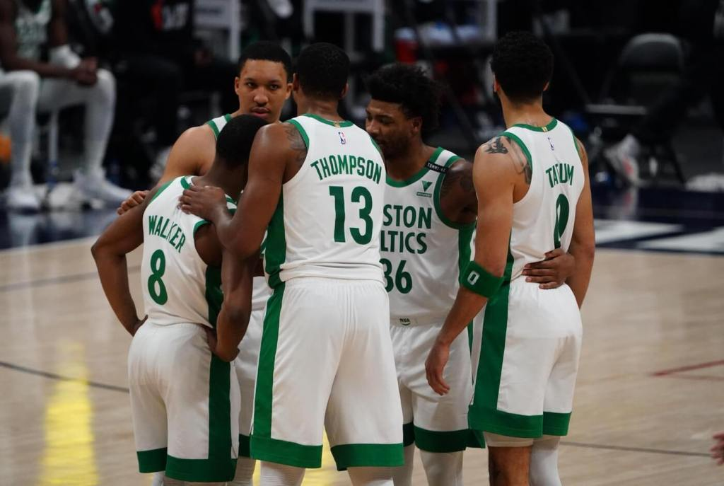 Apr 11, 2021; Denver, Colorado, USA; Boston Celtics forward Grant Williams (12) and guard Kemba Walker (8) and center Tristan Thompson (13) and guard Marcus Smart (36) and forward Jayson Tatum (0) huddle in the second quarter against the Denver Nuggets at Ball Arena. Mandatory Credit: Ron Chenoy-USA TODAY Sports