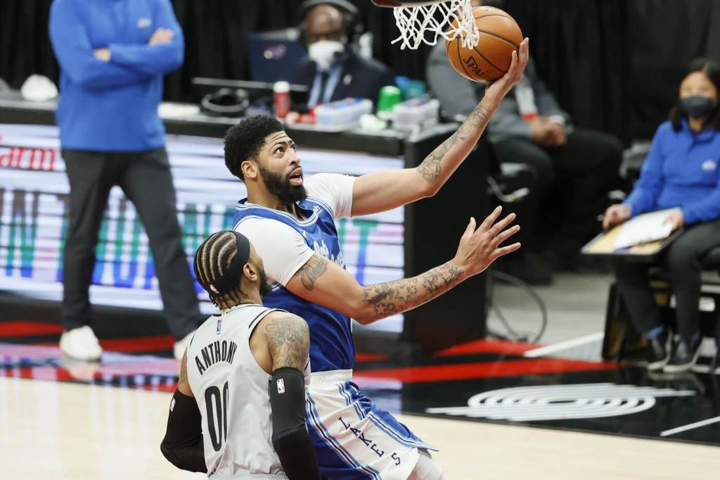May 7, 2021; Portland, Oregon, USA; Los Angeles Lakers power forward Anthony Davis (rear) goes to the basket against Portland Trail Blazers power forward Carmelo Anthony (00) during the first half at Moda Center. Mandatory Credit: Soobum Im-USA TODAY Sports