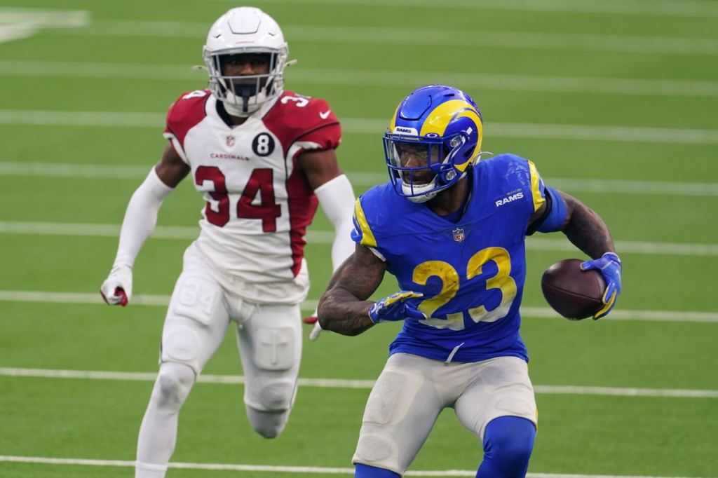 Jan 3, 2021; Inglewood, California, USA; Los Angeles Rams running back Cam Akers (23) is pursued by Arizona Cardinals free safety Jalen Thompson (34) in the second half at SoFi Stadium. The Rams defeated the Cardinals 18-7. Mandatory Credit: Kirby Lee-USA TODAY Sports