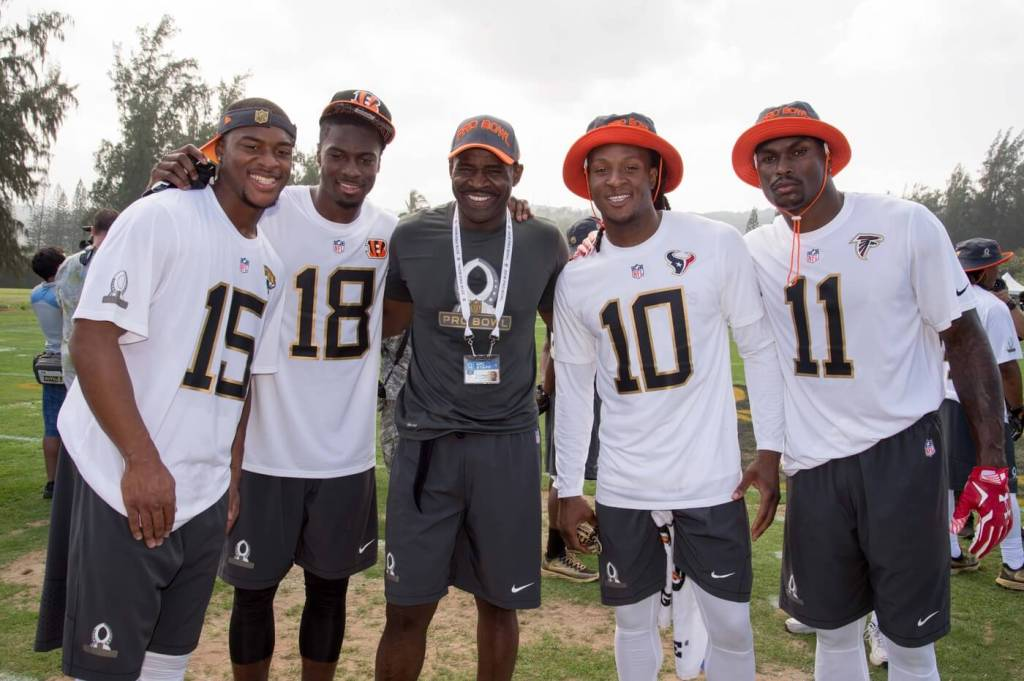 January 28, 2016; Kahuku, HI, USA; Team Irvin wide receiver Allen Robinson of the Jacksonville Jaguars (15), wide receiver A.J. Green of the Cincinnati Bengals (18), alumni captain Michael Irvin (center), wide receiver DeAndre Hopkins of the Houston Texans (10), and wide receiver Julio Jones of the Atlanta Falcons (11) pose for a photo during the 2016 Pro Bowl practice at Turtle Bay Resort. Mandatory Credit: Kyle Terada-USA TODAY Sports