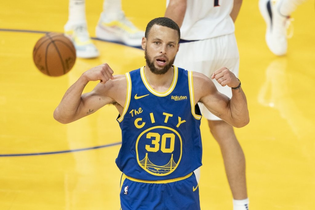 May 11, 2021; San Francisco, California, USA; Golden State Warriors guard Stephen Curry (30) celebrates after making a basket against the Phoenix Suns during the third quarter at Chase Center. Always a threat, Curry is one of the most Clutch NBA Players.Mandatory Credit: Kyle Terada-USA TODAY Sports