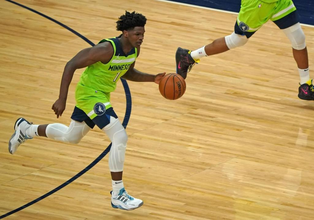 May 15, 2021; Minneapolis, Minnesota, USA; Minnesota Timberwolves forward Anthony Edwards (1) controls the ball against the Boston Celtics during the second quarter at Target Center. Mandatory Credit: Nick Wosika-USA TODAY Sports