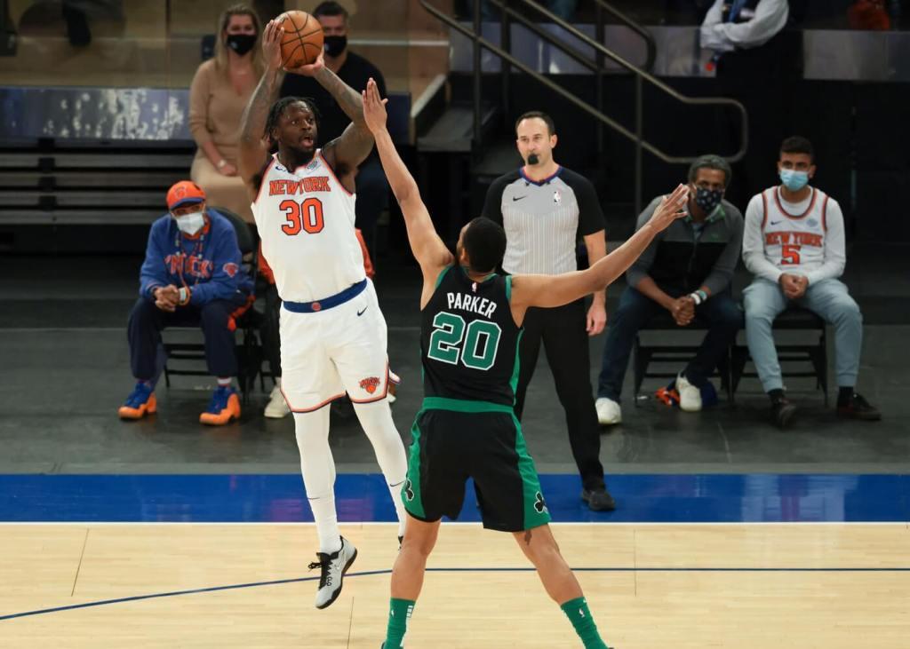 May 16, 2021; New York, New York, USA; New York Knicks forward Julius Randle (30) shoots the ball over Boston Celtics forward Jabari Parker (20) during the second half at Madison Square Garden. Mandatory Credit: Vincent Carchietta-USA TODAY Sports