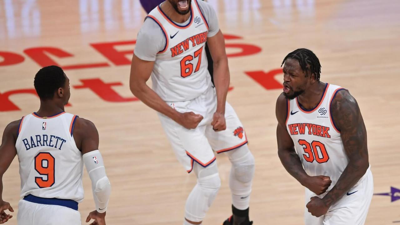 May 11, 2021; Los Angeles, California, USA; New York Knicks forward Julius Randle (30) celebrates after a three-point basket with guard RJ Barrett (9) and center Taj Gibson (67) during the overtime period against the Los Angeles Lakers at Staples Center. Mandatory Credit: Jayne Kamin-Oncea-USA TODAY Sports