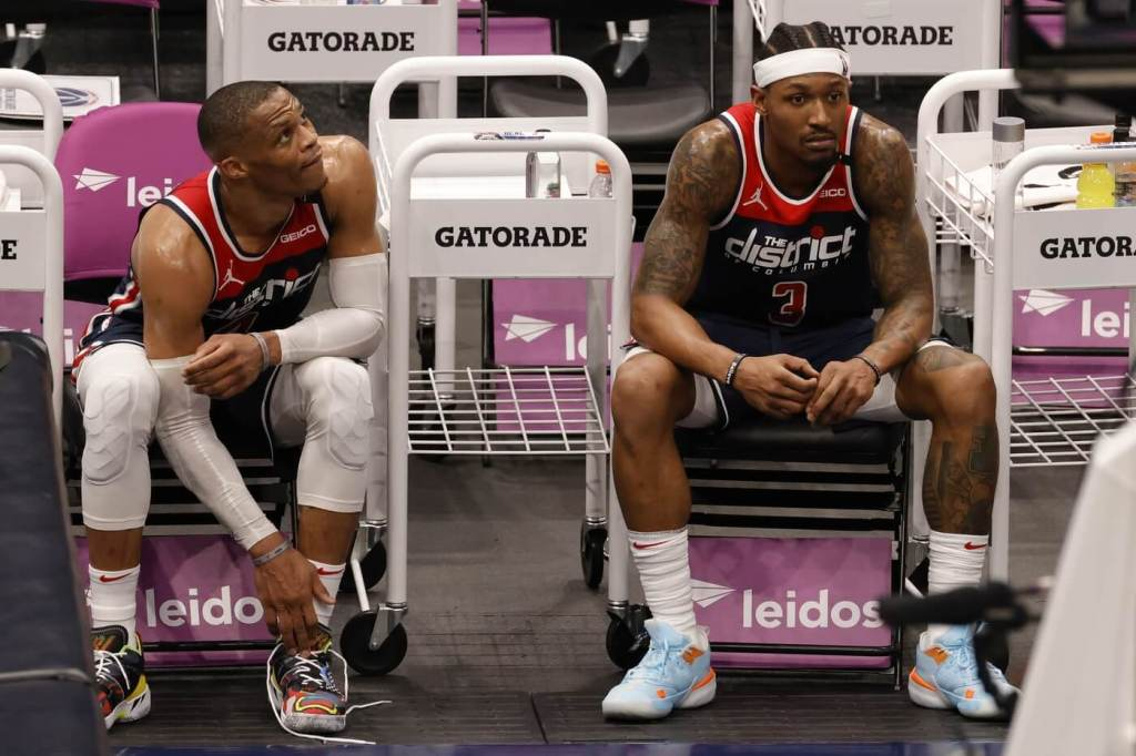 May 3, 2021; Washington, District of Columbia, USA; Washington Wizards guard Russell Westbrook (4) and Wizards guard Bradley Beal (3) sit on the bench in the final seconds of the fourth quarter against the Indiana Pacers at Capital One Arena. Mandatory Credit: Geoff Burke-USA TODAY Sports