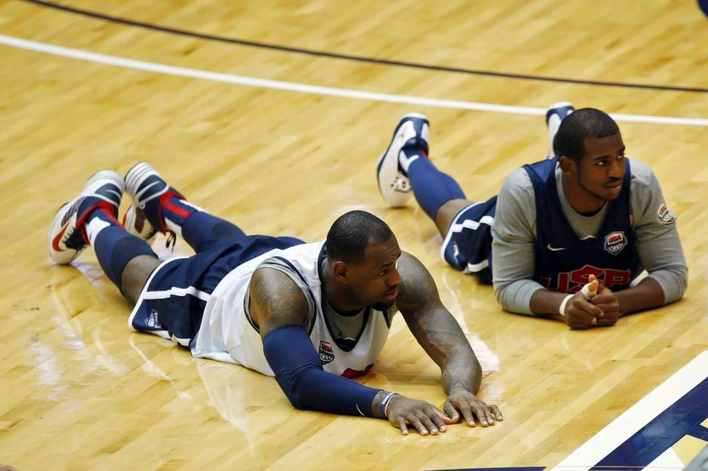 July 15, 2012; Washington, DC, USA; United States guard LeBron James (l) and United States guard Chris Paul (r) lie on the court during warm ups prior to USA team training at the Smith Center at George Washington University. Mandatory Credit: Geoff Burke-USA TODAY Sports