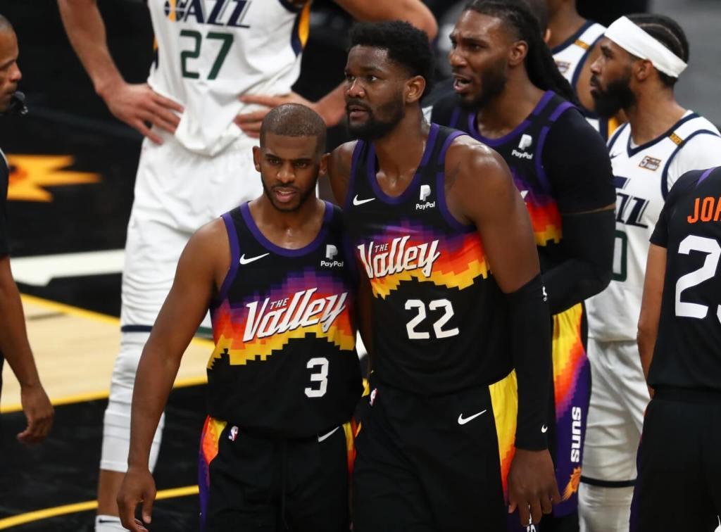 Apr 7, 2021; Phoenix, Arizona, USA; Phoenix Suns guard Chris Paul (3) and center Deandre Ayton (22) against the Utah Jazz at Phoenix Suns Arena. Mandatory Credit: Mark J. Rebilas-USA TODAY Sports