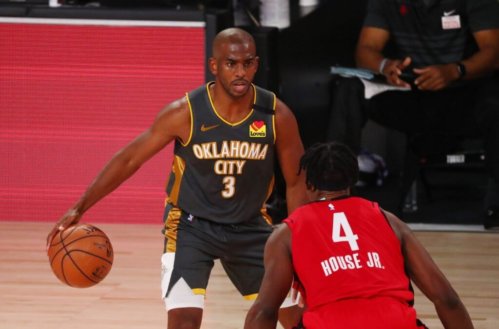 Aug 31, 2020; Lake Buena Vista, Florida, USA; Oklahoma City Thunder guard Chris Paul (3) is defended by Houston Rockets forward Danuel House Jr. (4) during the third quarter in game six of the first round of the 2020 NBA Playoffs at ESPN Wide World of Sports Complex. Mandatory Credit: Kim Klement-USA TODAY Sports