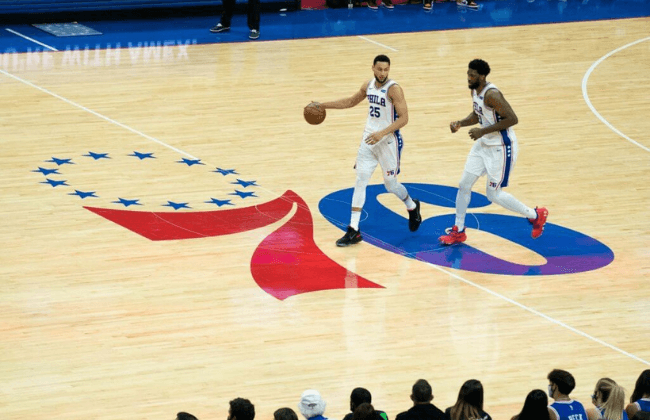 Jun 20, 2021; Philadelphia, Pennsylvania, USA; Philadelphia 76ers guard Ben Simmons (25) and center Joel Embiid (21) bring the ball up court against the Atlanta Hawks during the second quarter of game seven of the second round of the 2021 NBA Playoffs at Wells Fargo Center. Mandatory Credit: Bill Streicher-USA TODAY Sports
