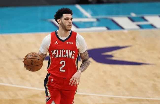 May 9, 2021; Charlotte, North Carolina, USA; New Orleans Pelicans guard Lonzo Ball (2) pushes the ball upcourt against the Charlotte Hornets in the first half at Spectrum Center. The New Orleans Pelicans won 112-110. Mandatory Credit: Nell Redmond-USA TODAY Sports