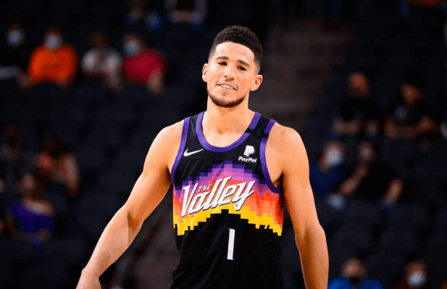 PHOENIX, AZ - FEBRUARY 7: Devin Booker #1 of the Phoenix Suns smiles during the game against the Boston Celtics on February 7, 2021 at Talking Stick Resort Arena in Phoenix, Arizona. NOTE TO USER: User expressly acknowledges and agrees that, by downloading and or using this photograph, user is consenting to the terms and conditions of the Getty Images License Agreement. Mandatory Copyright Notice: Copyright 2021 NBAE (Photo by Barry Gossage/NBAE via Getty Images)