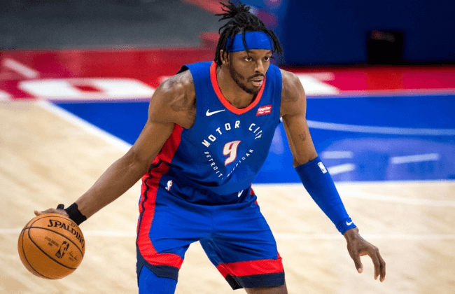 DETROIT, MICHIGAN - MARCH 15: Jerami Grant #9 of the Detroit Pistons dribbles the ball against the San Antonio Spurs during the first quarter of the NBA game at Little Caesars Arena on March 15, 2021 in Detroit, Michigan. NOTE TO USER: User expressly acknowledges and agrees that, by downloading and or using this photograph, User is consenting to the terms and conditions of the Getty Images License Agreement. (Photo by Nic Antaya/Getty Images)
