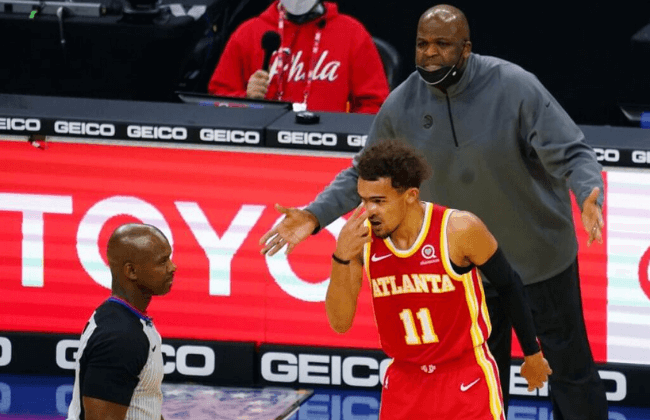 Apr 30, 2021; Philadelphia, Pennsylvania, USA; Atlanta Hawks head coach Nate McMillan and guard Trae Young (11) react to the referee during the third quarter against the Philadelphia 76ers at Wells Fargo Center. Mandatory Credit: James Lang-USA TODAY Sports