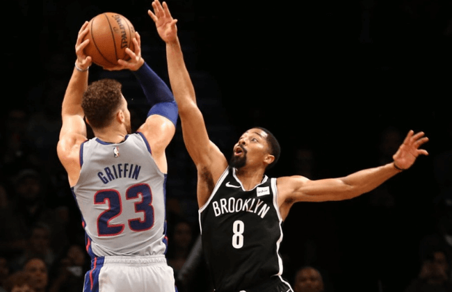 Oct 31, 2018; Brooklyn, NY, USA; Brooklyn Nets guard Spencer Dinwiddie (8) blocks a shot by Detroit Pistons forward Blake Griffin (23) in overtime at Barclays Center. Mandatory Credit: Nicole Sweet-USA TODAY Sports