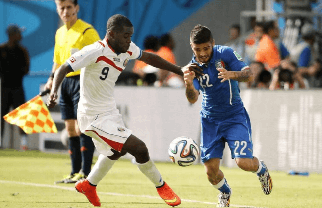 Jun 20, 2014; Recife, Pernambuco, BRAZIL; Costa Rica forward Joel Campbell (9) and Italy forward Lorenzo Insigne (22) battle for the ball during the second half of Costa Rica's 1-0 win in a 2014 World Cup game at Arena Pernambuco. Mandatory Credit: Winslow Townson-USA TODAY Sports