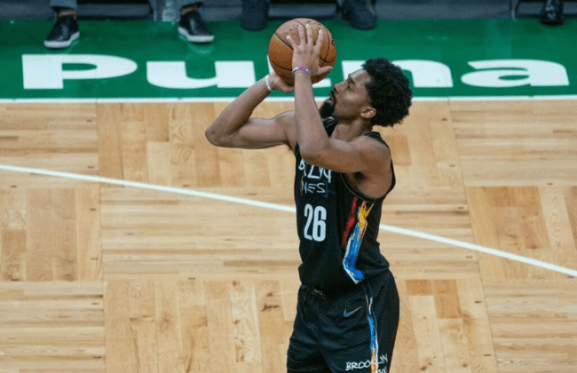 Dec 25, 2020; Boston, Massachusetts, USA; Brooklyn Nets point guard Spencer Dinwiddie (26) shoots a free throw during the third quarter against the Boston Celtics at TD Garden. Mandatory Credit: Gregory Fisher-USA TODAY Sports