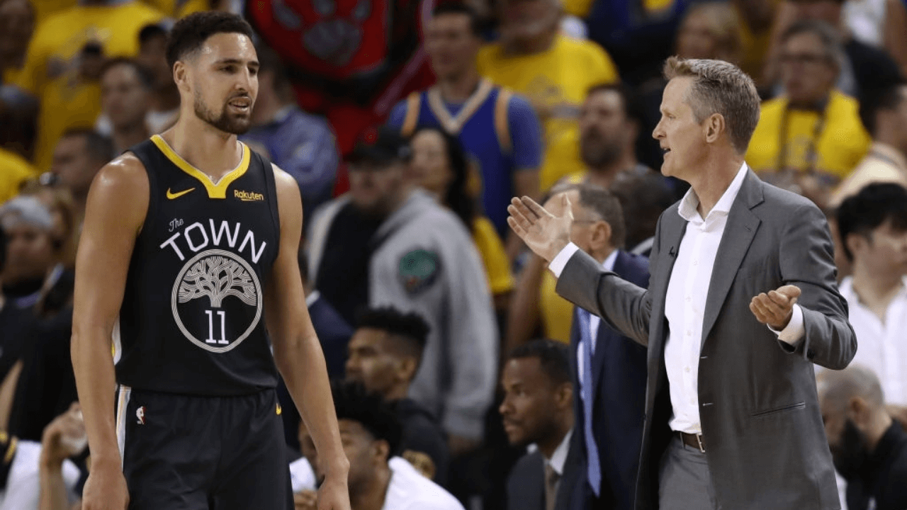 OAKLAND, CALIFORNIA - JUNE 07: Klay Thompson #11 and Head coach Steve Kerr of the Golden State Warriors react against the Toronto Raptors in the first half in the first half during Game Four of the 2019 NBA Finals at ORACLE Arena on June 07, 2019 in Oakland, California. NOTE TO USER: User expressly acknowledges and agrees that, by downloading and or using this photograph, User is consenting to the terms and conditions of the Getty Images License Agreement. (Photo by Ezra Shaw/Getty Images)