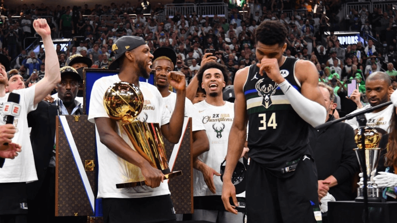 MILWAUKEE, WI - JULY 20: Khris Middleton #22 of the Milwaukee Bucks and Giannis Antetokounmpo #34 of the Milwaukee Bucks celebrate with the Larry O'Brien Trophy after winning Game Six of the 2021 NBA Finals against the Phoenix Suns on July 20, 2021 at Fiserv Forum in Milwaukee, Wisconsin. NOTE TO USER: User expressly acknowledges and agrees that, by downloading and/or using this Photograph, user is consenting to the terms and conditions of the Getty Images License Agreement. Mandatory Copyright Notice: Copyright 2021 NBAE (Photo by Jesse D. Garrabrant/NBAE via Getty Images)