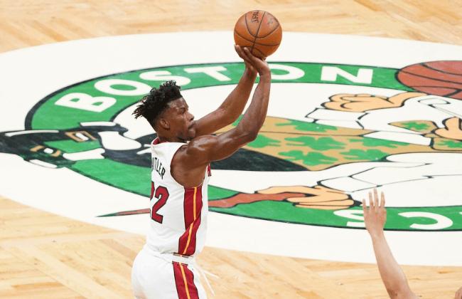 May 11, 2021; Boston, Massachusetts, USA; Miami Heat forward Jimmy Butler (22) shoots against the Boston Celtics in the first quarter at TD Garden.