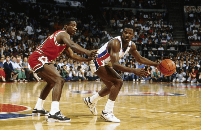 May 1989; Detroit, MI, USA: FILE PHOTO; Detroit Pistons guard Joe Dumars (4) is defended by Chicago Bulls guard Sam Vincent (11) during the 1988-89 NBA Eastern Conference Finals at The Palace. The Pistons defeated the Bulls 4 games to 2