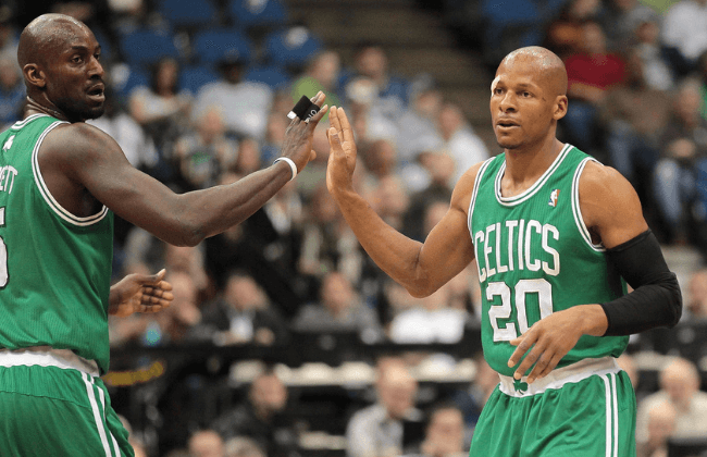 Mar 27, 2011; Minneapolis, MN, USA; Boston Celtics guard Ray Allen (20) slaps hands with Kevin Garnett (5) after making a shot in the first half against the Minnesota Timberwolves at Target Center.