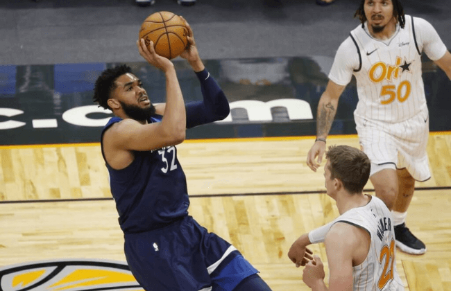 May 9, 2021; Orlando, Florida, USA; Minnesota Timberwolves center Karl-Anthony Towns (32) makes a basket as he gets fouled by Orlando Magic center Moritz Wagner (21) and shoots and one during the first half at Amway Center. Mandatory Credit: Kim Klement-USA TODAY Sports