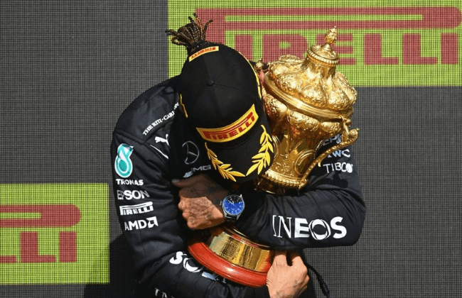 NORTHAMPTON, ENGLAND - JULY 18: Race winner Lewis Hamilton of Great Britain and Mercedes GP celebrates on the podium during the F1 Grand Prix of Great Britain at Silverstone on July 18, 2021 in Northampton, England.