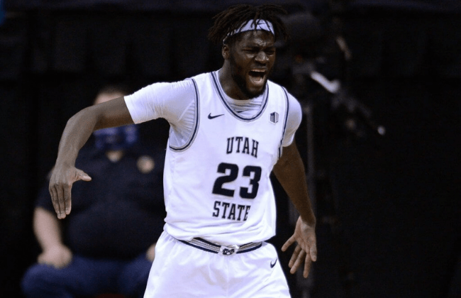 Mar 12, 2021; Las Vegas, Nevada, USA; Utah State Aggies center Neemias Queta (23) reacts after dunking the ball and being fouled during the second half against the Colorado State Rams at Thomas & Mack Center.