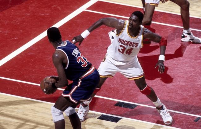 Jun 1994, USA: FILE PHOTO; Houston Rockets center Hakeem Olajuwon (34) defends New York Knicks center Patrick Ewing (33) during the 1994 NBA Finals at the Summit. Mandatory Credit: MPS-USA TODAY Sports