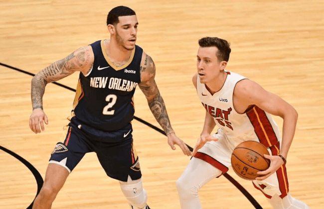 Dec 14, 2020; Miami, Florida, USA; Miami Heat guard Duncan Robinson (55) dribbles the ball around New Orleans Pelicans guard Lonzo Ball (2) during the second half at American Airlines Arena. Mandatory Credit: Jasen Vinlove-USA TODAY Sports