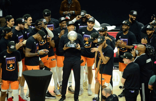 Jun 30, 2021; Los Angeles, California, USA; Phoenix Suns head coach Monty Williams lifts the Western Conference champions trophy following the series victory against the Los Angeles Clippers in game six of the Western Conference Finals for the 2021 NBA Playoffs at Staples Center. Mandatory Credit: Gary A. Vasquez-USA TODAY Sports