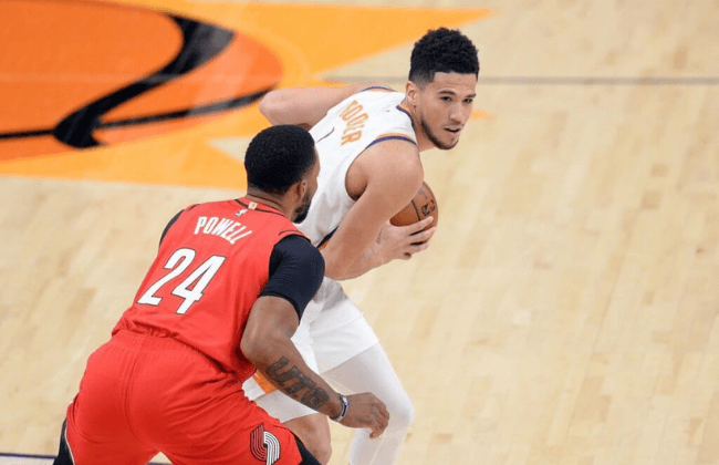 May 13, 2021; Phoenix, Arizona, USA; Phoenix Suns guard Devin Booker (1) controls the ball while defended by Portland Trail Blazers forward Norman Powell (24) during the second half at Phoenix Suns Arena. Mandatory Credit: Joe Camporeale-USA TODAY Sports