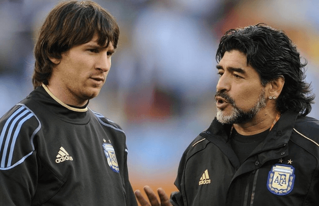 Argentina's coach Diego Maradona (R) speaks to Argentina's striker Lionel Messi prior the 2010 World Cup quarter-final match Argentina vs. Germany on July 3, 2010 at Green Point stadium in Cape Town.  NO PUSH TO MOBILE / MOBILE USE SOLELY WITHIN EDITORIAL ARTICLE -   AFP PHOTO / JAVIER SORIANO (Photo credit should read JAVIER SORIANO/AFP via Getty Images)