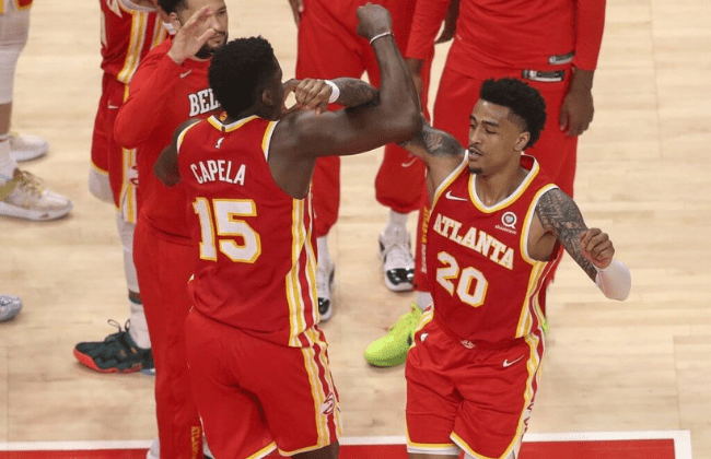 May 28, 2021; Atlanta, Georgia, USA; Atlanta Hawks center Clint Capela (15) and forward John Collins (20) celebrate against the New York Knicks in the fourth quarter during game three in the first round of the 2021 NBA Playoffs at State Farm Arena. Mandatory Credit: Brett Davis-USA TODAY Sports