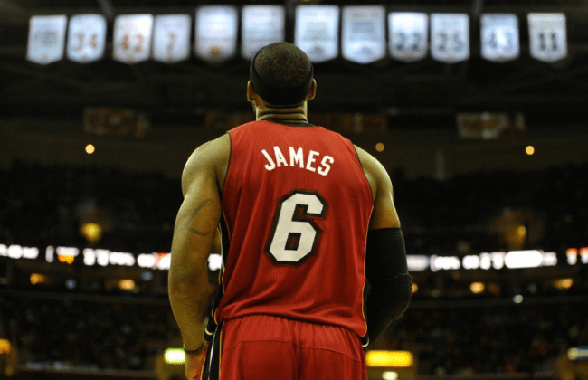 Mar 18, 2014; Cleveland, OH, USA; Miami Heat forward LeBron James (6) stands under the retired jersey numbers of the Cleveland Cavaliers at Quicken Loans Arena. Miami won 100-96. Mandatory Credit: David Richard-USA TODAY Sports