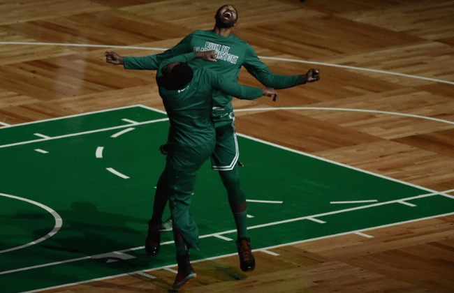 Feb 17, 2021; Boston, Massachusetts, USA; Boston Celtics forward Tristan Thompson (13) reacts with a teammate after being introduced prior to a game against the Atlanta Hawks at TD Garden. Mandatory Credit: Bob DeChiara-USA TODAY Sports