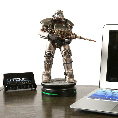The Fallout T-51 Power Armor Statue. From the image, it appears a little taller than an open 13 inch macbook air. Image from THINKGEEK.com: https://www.thinkgeek.com/product/ktgo/