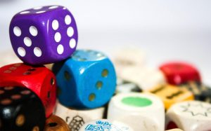 A photo of various dice and game pieces stacked on top of one another.
