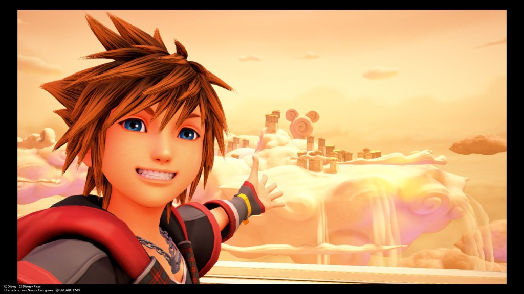 Sora takes a selfie in front of a swirly Lucky Emblem made out of a fluffy cloud. Kingdom Hearts III, Square Enix, 2019.