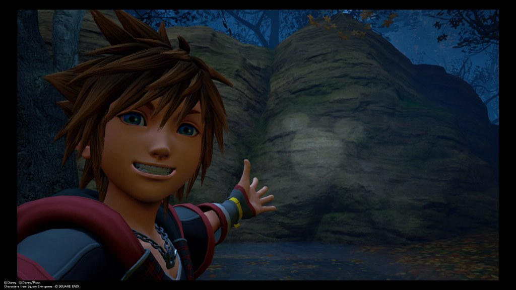 Sora takes a selfie in front of Lucky Emblem found on a rock in Corona. Kingdom Hearts III, Square Enix, 2019.