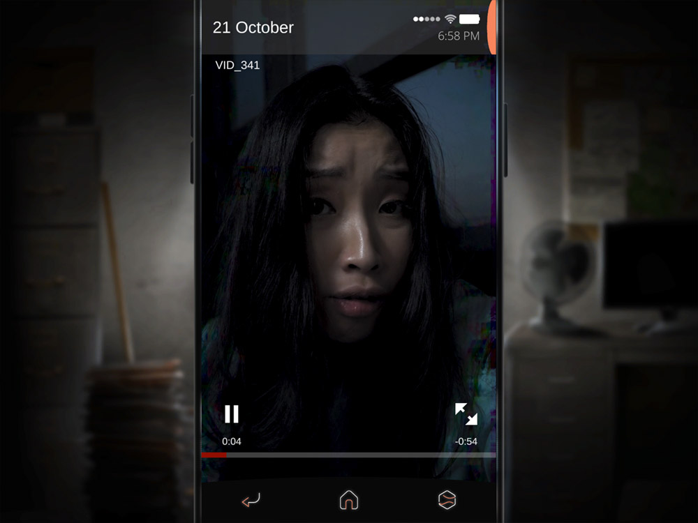 A video player shows a young woman looking distressed, staring at the viewer, in a dimly lit room. The video if artifacting and appears corrupted. From SIMULACRA 2, Kaigan Games, 2020.