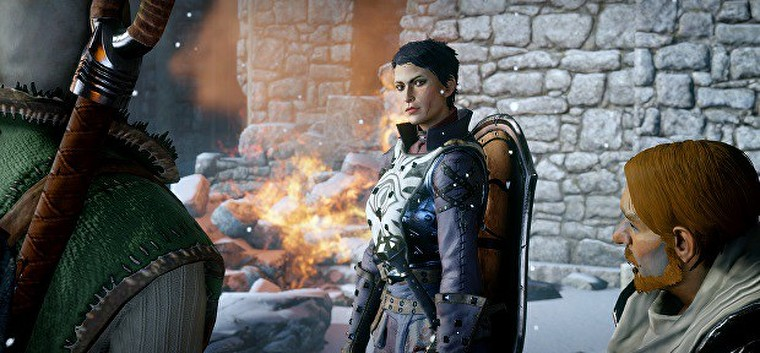 A still frame of Cassandra from Dragon Age, a light-skinned brunette with a pixie cut, wearing armor with the Seekers' eye on her chest and a shield on her back. Dragon Age: Inquisition, BioWare, Electronic Arts, 2014