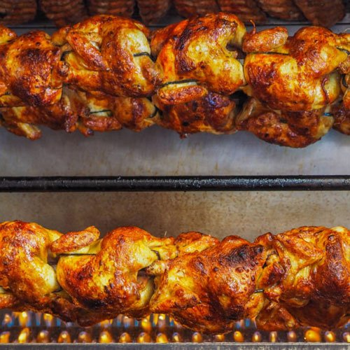 Chickens on rotisserie.