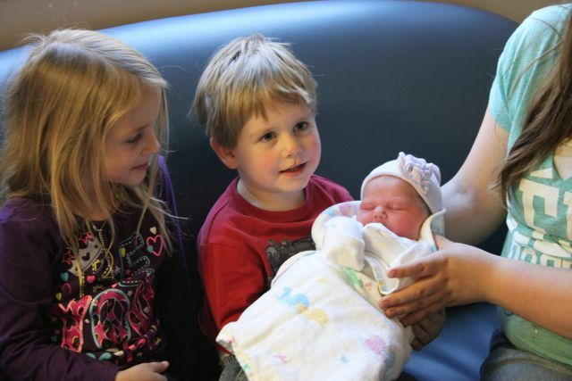 Big Brother holding her for the 1st time.