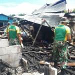 Pasca Kebakaran, Satgas Yonif MR 413 Kostrad Bersihkan Area Dok IX Jayapura