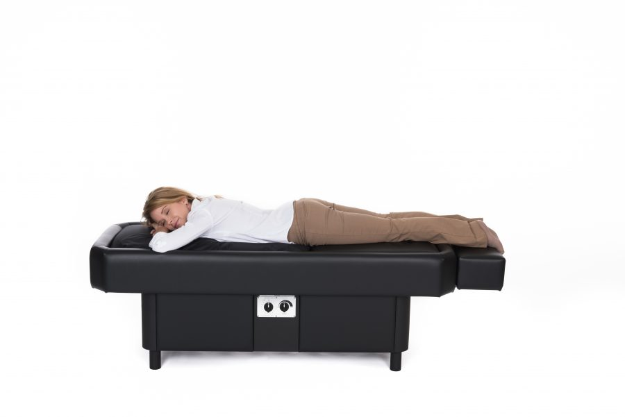 woman laying on stomach on hydromassage table