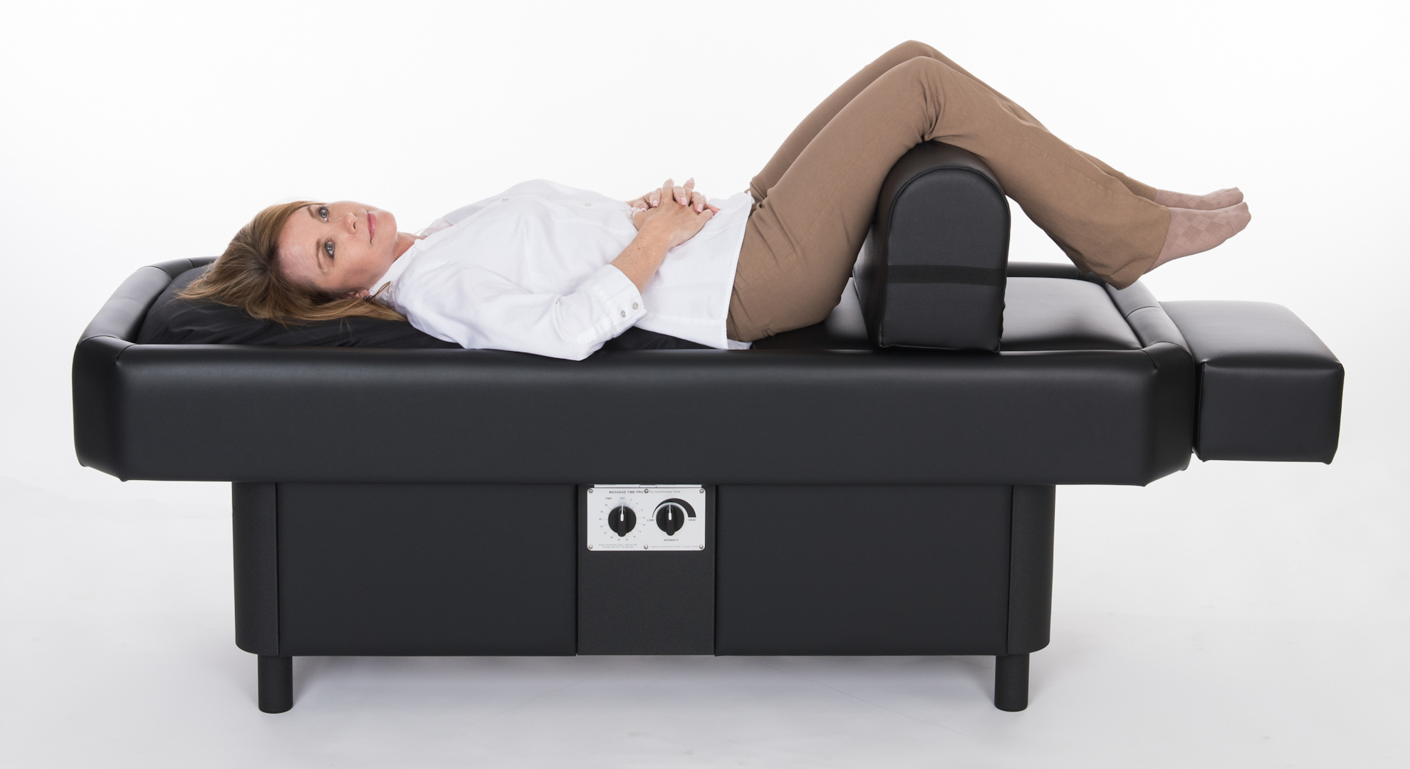 lady on hydromassage table with leg bolster standing up
