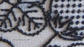Blackwork Forehead Cloth - WIP3 - detail2 - Close up to show the detail of how flat silk twists more or less with different stitches as I work - by Sidney Eileen